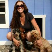 Rosie, Rusty & baby Autumn in front of their doghouse